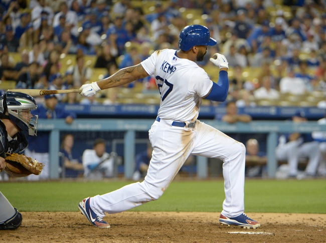 Jul 30, 2014; Los Angeles, CA, USA; Los Angeles Dodgers right fielder Matt Kemp (27) follows through on a walk-off single in the 10th inning against the Atlanta Braves at Dodger Stadium. The Dodgers defeated the Braves 2-1 in 10 innings. Mandatory Credit: Kirby Lee-USA TODAY Sports