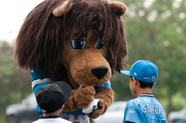Aug 2, 2014; Detroit, MI, USA; Detroit Lions mascot Roary signs autographs during training camp at the Lions training facility. Mandatory Credit: Tim Fuller-USA TODAY Sports