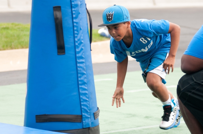 Aug 2, 2014; Detroit, MI, USA; A young Detroit Lions fan participates in drills prior to the Lions training camp at the Lions training facility. Mandatory Credit: Tim Fuller-USA TODAY Sports