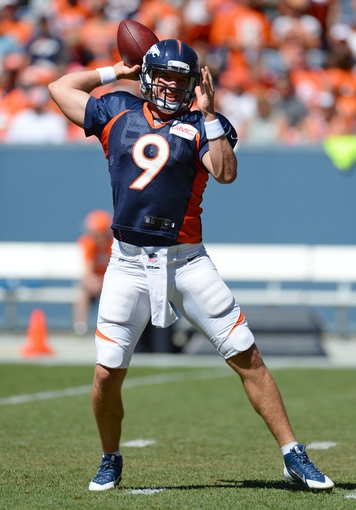 Aug 2, 2014; Denver, CO, USA; Denver Broncos quarterback Bryn Renner (9) prepares to throw as he warms up prior to the start of a scrimmage at Sports Authority Field. Mandatory Credit: Ron Chenoy-USA TODAY Sports