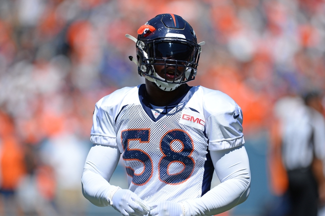 Aug 2, 2014; Denver, CO, USA; Denver Broncos outside linebacker Von Miller (58) prior to the start of a scrimmage at Sports Authority Field. Mandatory Credit: Ron Chenoy-USA TODAY Sports