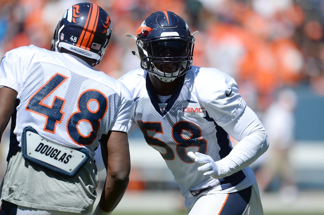 Aug 2, 2014; Denver, CO, USA; Denver Broncos outside linebacker Von Miller (58) and linebacker Shaquil Barrett (48) warm up prior to the start of a scrimmage at Sports Authority Field. Mandatory Credit: Ron Chenoy-USA TODAY Sports