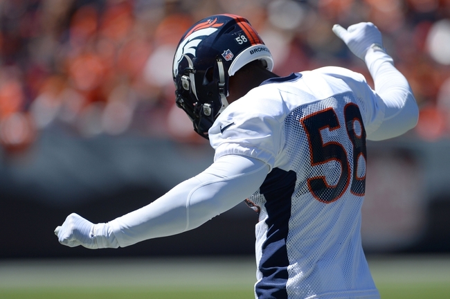 Aug 2, 2014; Denver, CO, USA; Denver Broncos outside linebacker Von Miller (58) dances prior to the start of a scrimmage at Sports Authority Field. Mandatory Credit: Ron Chenoy-USA TODAY Sports