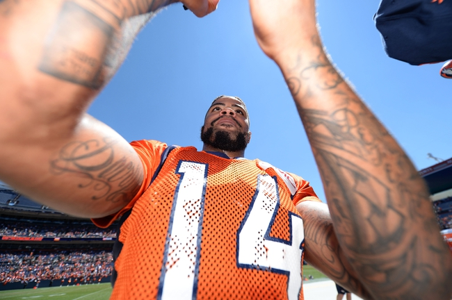 Aug 2, 2014; Denver, CO, USA; Denver Broncos wide receiver Cody Latimer (14) signs autographs following a scrimmage at Sports Authority Field. Mandatory Credit: Ron Chenoy-USA TODAY Sports