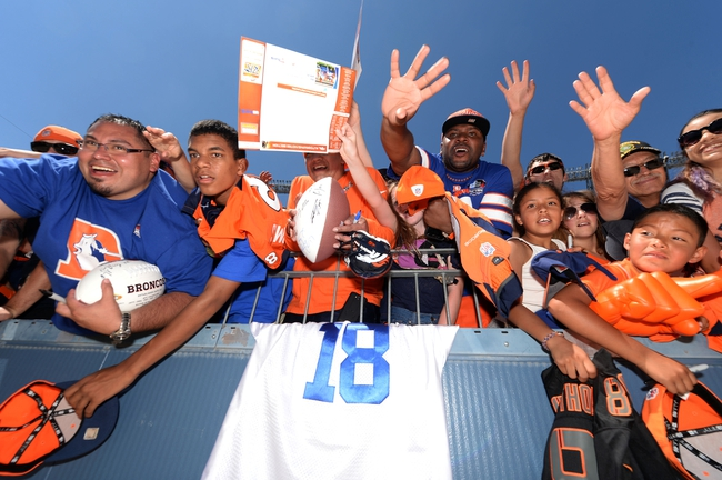 Aug 2, 2014; Denver, CO, USA; Denver Broncos fans attempt to get autographs following a scrimmage at Sports Authority Field. Mandatory Credit: Ron Chenoy-USA TODAY Sports