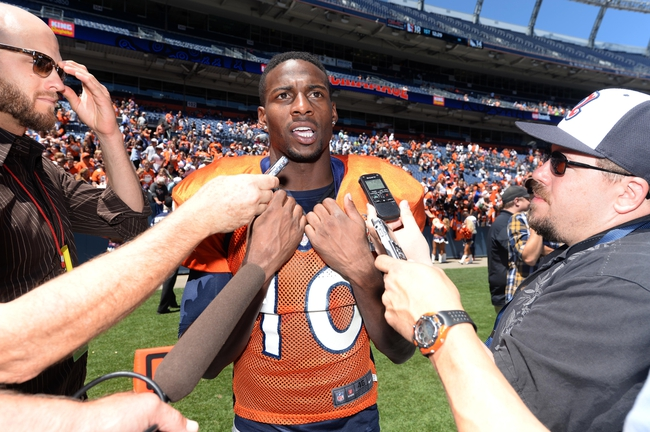Aug 2, 2014; Denver, CO, USA; Denver Broncos wide receiver Emmanuel Sanders (10) talks to the media following a scrimmage at Sports Authority Field. Mandatory Credit: Ron Chenoy-USA TODAY Sports