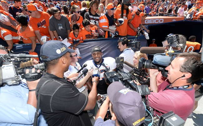 Aug 2, 2014; Denver, CO, USA; Denver Broncos strong safety T.J. Ward (43) talks to the media following a scrimmage at Sports Authority Field. Mandatory Credit: Ron Chenoy-USA TODAY Sports