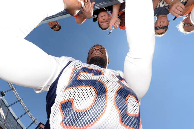 Aug 2, 2014; Denver, CO, USA; Denver Broncos outside linebacker Von Miller (58) signs autographs following a scrimmage at Sports Authority Field. Mandatory Credit: Ron Chenoy-USA TODAY Sports