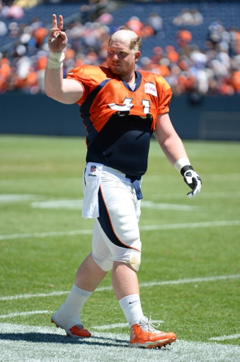 Aug 2, 2014; Denver, CO, USA; Denver Broncos center Matt Paradis (61) leaves the field following a scrimmage at Sports Authority Field. Mandatory Credit: Ron Chenoy-USA TODAY Sports