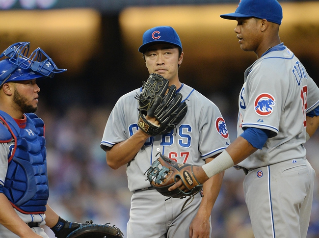 Aug 2, 2014; Los Angeles, CA, USA;  Chicago Cubs catcher Welington Castillo (5) and shortstop Starlin Castro (13) talk with starting pitcher Tsuyoshi Wada (67) in the fourth inning of the game against the Los Angeles Dodgers at Dodger Stadium. Mandatory Credit: Jayne Kamin-Oncea-USA TODAY Sports