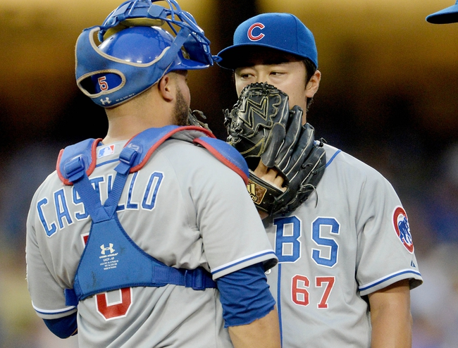 Aug 2, 2014; Los Angeles, CA, USA;  Chicago Cubs catcher Welington Castillo (5) talks with starting pitcher Tsuyoshi Wada (67) in the fourth inning of the game against the Los Angeles Dodgers at Dodger Stadium. Mandatory Credit: Jayne Kamin-Oncea-USA TODAY Sports