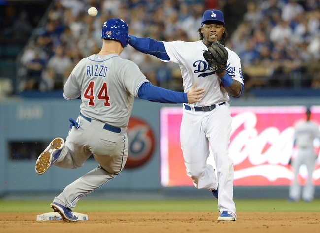 Aug 2, 2014; Los Angeles, CA, USA;  Los Angeles Dodgers shortstop Hanley Ramirez (13) throws to first base as Chicago Cubs first baseman Anthony Rizzo (44) is out on a double play in the sixth inning of the game at Dodger Stadium. Mandatory Credit: Jayne Kamin-Oncea-USA TODAY Sports