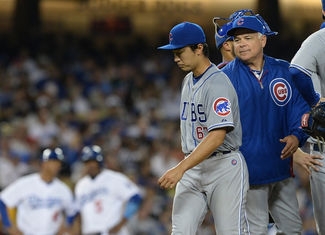 Aug 2, 2014; Los Angeles, CA, USA;  Chicago Cubs manager Rick Renteria (16) pulls Chicago Cubs starting pitcher Tsuyoshi Wada (67) in the sixth inning of the game against the Los Angeles Dodgers at Dodger Stadium. Mandatory Credit: Jayne Kamin-Oncea-USA TODAY Sports