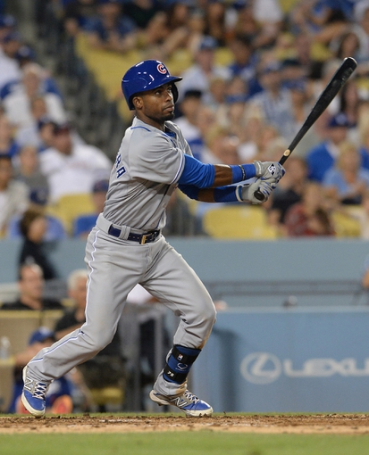 Aug 2, 2014; Los Angeles, CA, USA;  Chicago Cubs second baseman Arismendy Alcantara (7) hits a RBI triple in the seventh inning of the game against the Los Angeles Dodgers at Dodger Stadium. Mandatory Credit: Jayne Kamin-Oncea-USA TODAY Sports