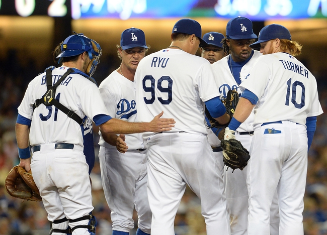 Aug 2, 2014; Los Angeles, CA, USA;  Los Angeles Dodgers manager Don Mattingly (8) talks to starting pitcher Hyun-Jin Ryu (99) on the mound as catcher Drew Butera (31) pats him on the back in the seventh inning of the game against the Chicago Cubs at Dodger Stadium. Mandatory Credit: Jayne Kamin-Oncea-USA TODAY Sports
