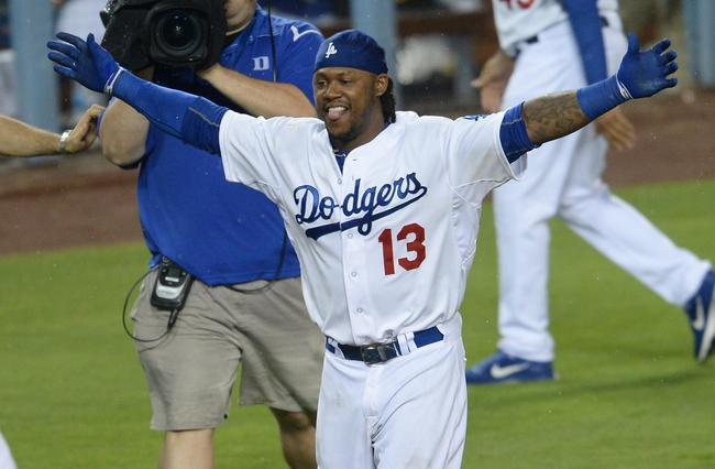 Aug 2, 2014; Los Angeles, CA, USA;  Los Angeles Dodgers shortstop Hanley Ramirez (13) celebrates at home plate after hitting a walk off 3-run home run in the twelfth inning of the game against the Chicago Cubs at Dodger Stadium. Dodgers won 5-2. Mandatory Credit: Jayne Kamin-Oncea-USA TODAY Sports