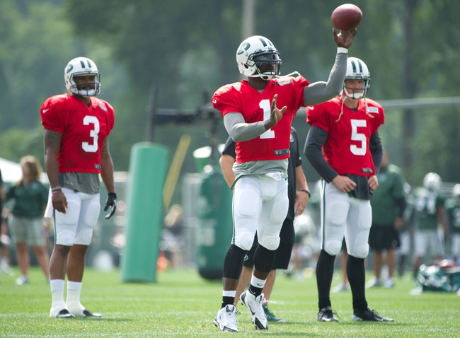 Aug 4, 2014; Cortland, NY, USA; New York Jets quarterback Michael Vick (1) passes the ball during training camp at SUNY Cortland. Mandatory Credit: Rich Barnes-USA TODAY Sports