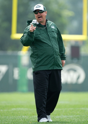 Aug 4, 2014; Cortland, NY, USA; New York Jets offensive coordinator Marty Mornhinweg gives instructions during drills at training camp at SUNY Cortland. Mandatory Credit: Rich Barnes-USA TODAY Sports