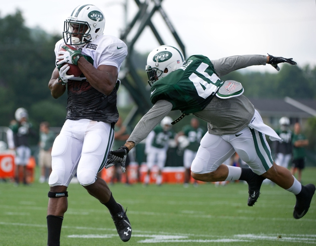Aug 4, 2014; Cortland, NY, USA; New York Jets wide receiver Quincy Enunwa (left) runs with the ball after a catch in front of defensive back Rontez Miles (45) during training camp at SUNY Cortland. Mandatory Credit: Rich Barnes-USA TODAY Sports