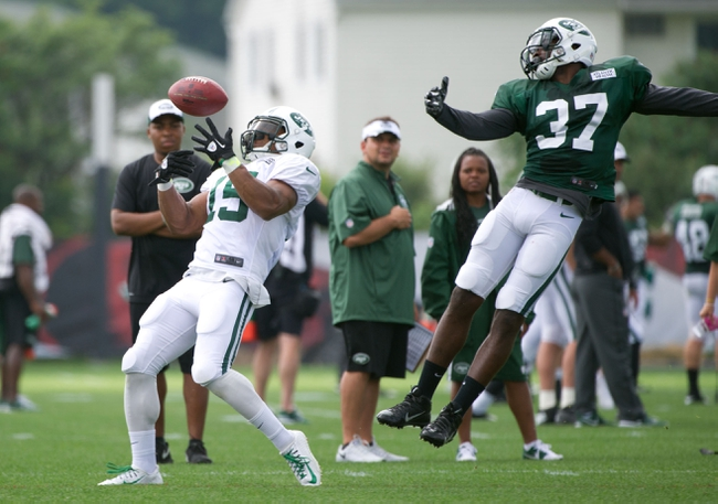 Aug 4, 2014; Cortland, NY, USA; New York Jets wide receiver Saalim Hakim (15) makes a catch in front of free safety Jaiquawn Jarrett (37) during training camp at SUNY Cortland. Mandatory Credit: Rich Barnes-USA TODAY Sports