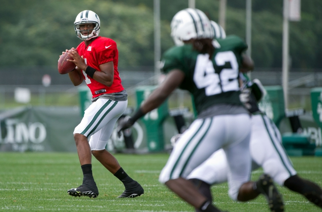 Aug 4, 2014; Cortland, NY, USA; New York Jets quarterback Geno Smith (7) drops back to pass during training camp at SUNY Cortland. Mandatory Credit: Rich Barnes-USA TODAY Sports