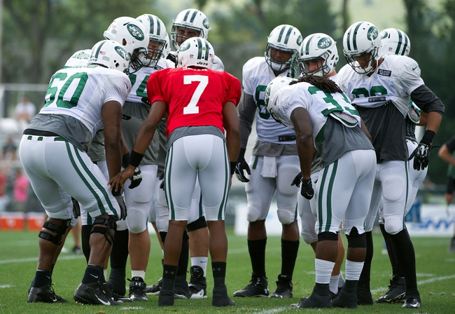 Aug 4, 2014; Cortland, NY, USA; New York Jets quarterback Geno Smith (7) calls a play in the huddle during training camp at SUNY Cortland. Mandatory Credit: Rich Barnes-USA TODAY Sports