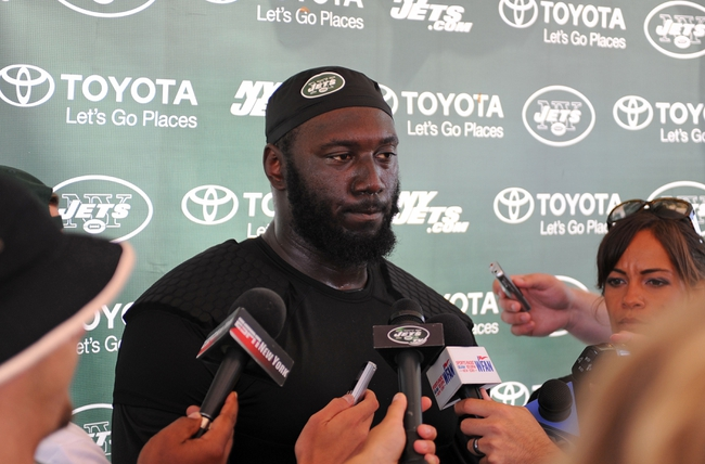 Aug 4, 2014; Cortland, NY, USA; New York Jets defensive end Muhammad Wilkerson (96) speaks with the media following training camp at SUNY Cortland. Mandatory Credit: Rich Barnes-USA TODAY Sports
