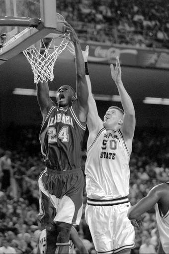 Mar 18, 1995;  Alabama Crimson Tide forward Antonio McDyess (24) dunks the ball in front of Oklahoma State Cowboys center Bryant Reeves (50) at the Meadowlands Arena in the second round of the1995 NCAA Men's Basketball Tournament. Mandatory Credit: H. Darr Beiser-USA TODAY Sports