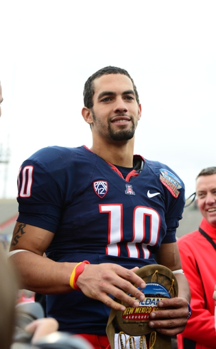 Dec. 15, 2012; Albuquerque, NM, USA; Arizona Wildcats quarterback Matt Scott with the offensive player of the game award against the Nevada Wolf Pack in the 2012 New Mexico Bowl at University Stadium. Mandatory Credit: Mark J. Rebilas-USA TODAY Sports