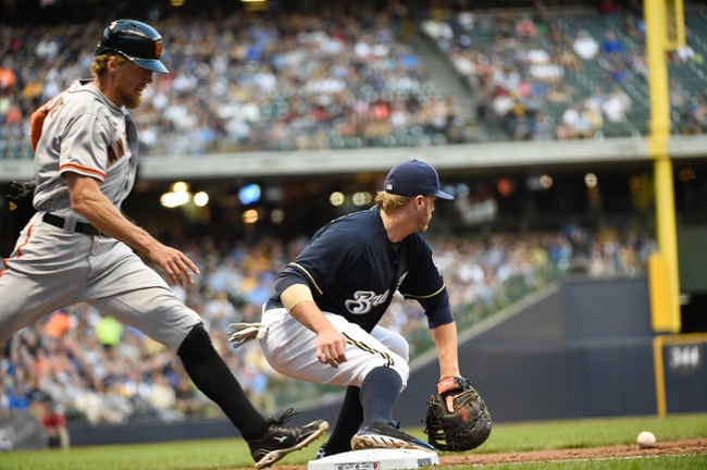 Aug 5, 2014; Milwaukee, WI, USA;  San Francisco Giants right fielder Hunter Pence (8) beats out an infield hit before Milwaukee Brewers first baseman Mark Reynolds (7) can field the ball in the third inning at Miller Park. Mandatory Credit: Benny Sieu-USA TODAY Sports