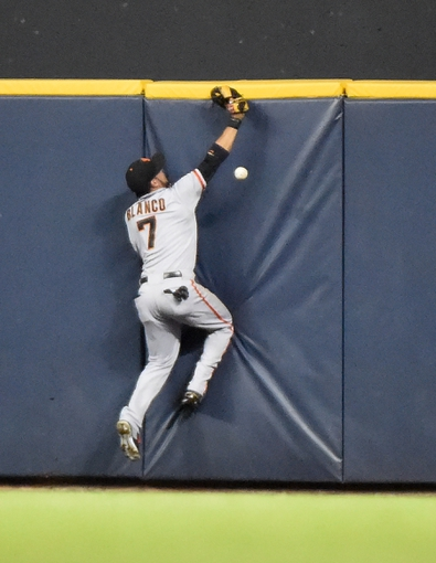 Aug 5, 2014; Milwaukee, WI, USA;  San Francisco Giants center fielder Gregor Blanco (7) can't catch ball hit by Milwaukee Brewers catcher Jonathan Lucroy (20) for a double in the sixth inning at Miller Park. Mandatory Credit: Benny Sieu-USA TODAY Sports