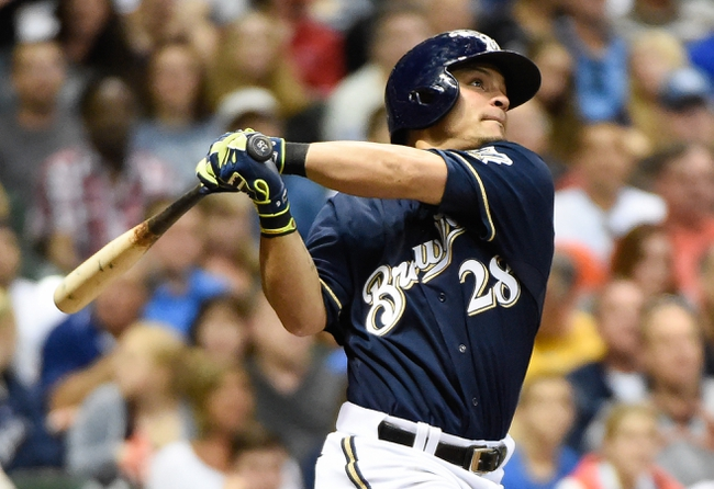 Aug 5, 2014; Milwaukee, WI, USA;  Milwaukee Brewers right fielder Gerardo Parra (28) hits a solo home run in the seventh inning against the San Francisco Giants at Miller Park. Mandatory Credit: Benny Sieu-USA TODAY Sports