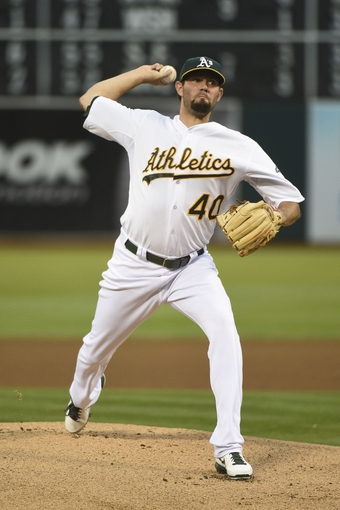 August 5, 2014; Oakland, CA, USA; Oakland Athletics starting pitcher Jason Hammel (40) delivers a pitch against the Tampa Bay Rays during the first inning at O.co Coliseum. Mandatory Credit: Kyle Terada-USA TODAY Sports
