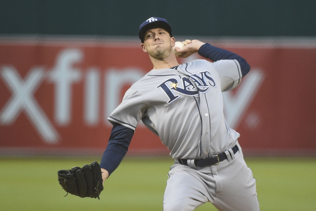 August 5, 2014; Oakland, CA, USA; Tampa Bay Rays starting pitcher Drew Smyly (33) delivers a pitch against the Oakland Athletics during the first inning at O.co Coliseum. Mandatory Credit: Kyle Terada-USA TODAY Sports