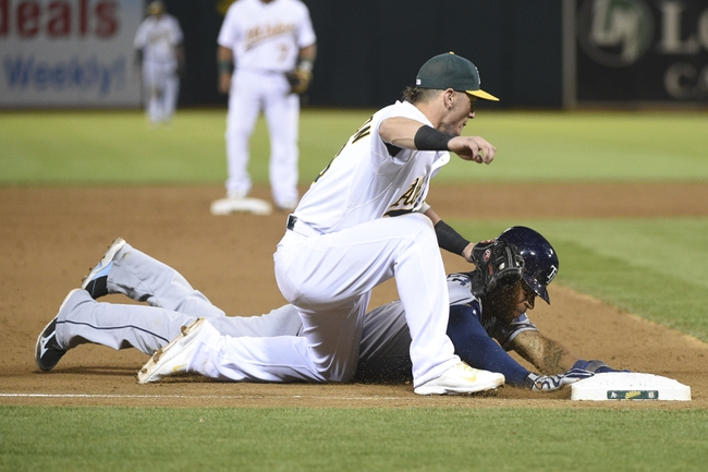 August 5, 2014; Oakland, CA, USA; Tampa Bay Rays center fielder Desmond Jennings (8, bottom) is tagged out by Oakland Athletics third baseman Josh Donaldson (20, top) during the fifth inning at O.co Coliseum. Mandatory Credit: Kyle Terada-USA TODAY Sports