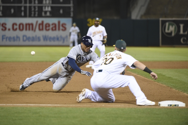 August 5, 2014; Oakland, CA, USA; Tampa Bay Rays center fielder Desmond Jennings (8, left) is tagged out by Oakland Athletics third baseman Josh Donaldson (20, right) during the fifth inning at O.co Coliseum. Mandatory Credit: Kyle Terada-USA TODAY Sports