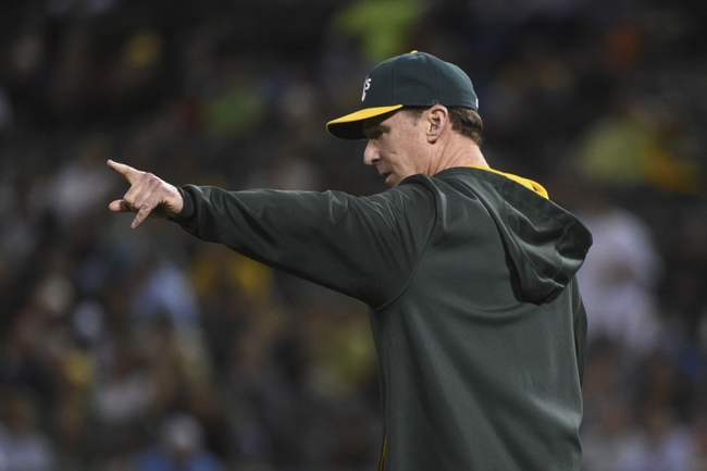 August 5, 2014; Oakland, CA, USA; Oakland Athletics manager Bob Melvin (6) signals for a pitching change against the Tampa Bay Rays during the sixth inning at O.co Coliseum. Mandatory Credit: Kyle Terada-USA TODAY Sports