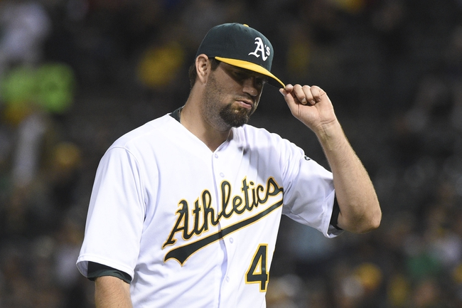 August 5, 2014; Oakland, CA, USA; Oakland Athletics starting pitcher Jason Hammel (40) acknowledges the crowd after being removed from the game against the Tampa Bay Rays during the sixth inning at O.co Coliseum. Mandatory Credit: Kyle Terada-USA TODAY Sports