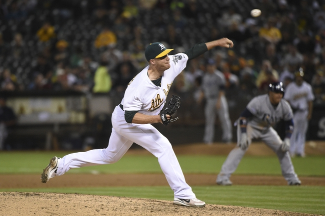 August 5, 2014; Oakland, CA, USA; Oakland Athletics relief pitcher Eric O'Flaherty (39) delivers a pitch against the Tampa Bay Rays during the sixth inning at O.co Coliseum. Mandatory Credit: Kyle Terada-USA TODAY Sports