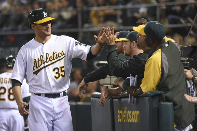 August 5, 2014; Oakland, CA, USA; Oakland Athletics first baseman Nate Freiman (35) is congratulated for scoring on a RBI-single by right fielder Josh Reddick (16, not pictured) against the Tampa Bay Rays during the sixth inning at O.co Coliseum. Mandatory Credit: Kyle Terada-USA TODAY Sports