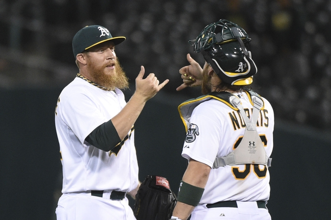 August 5, 2014; Oakland, CA, USA; Oakland Athletics relief pitcher Sean Doolittle (62, left) celebrates with catcher Derek Norris (36, right) after the game against the Tampa Bay Rays at O.co Coliseum. The Athletics defeated the Rays 3-0. Mandatory Credit: Kyle Terada-USA TODAY Sports