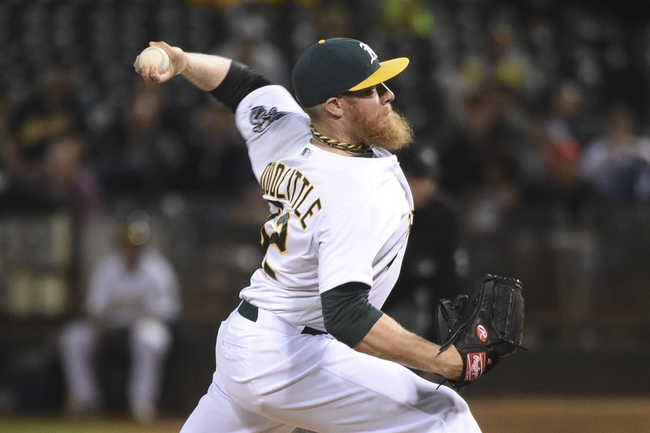 August 5, 2014; Oakland, CA, USA; Oakland Athletics relief pitcher Sean Doolittle (62) delivers a pitch against the Tampa Bay Rays during the ninth inning at O.co Coliseum. The Athletics defeated the Rays 3-0. Mandatory Credit: Kyle Terada-USA TODAY Sports