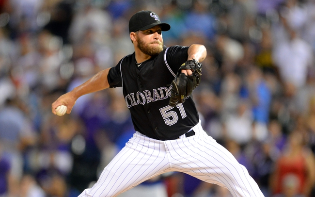 Aug 6, 2014; Denver, CO, USA; Colorado Rockies relief pitcher Brooks Brown (51) delivers a pitch in the ninth inning against the Chicago Cubs at Coors Field. The Rockies defeated the Cubs 13-4. Mandatory Credit: Ron Chenoy-USA TODAY Sports