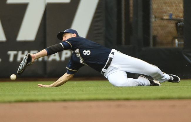 Aug 7, 2014; Milwaukee, WI, USA;  Milwaukee Brewers right fielder Ryan Braun (8) can't catch ball hit by San Francisco Giants center fielder Angel Pagan (not pictured) that fell for a single in the first inning at Miller Park. Mandatory Credit: Benny Sieu-USA TODAY Sports