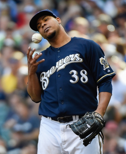 Aug 7, 2014; Milwaukee, WI, USA;  Milwaukee Brewers pitcher Wily Peralta (38) plays with the ball between pitches in the sixth inning during the game against the San Francisco Giants at Miller Park. Mandatory Credit: Benny Sieu-USA TODAY Sports