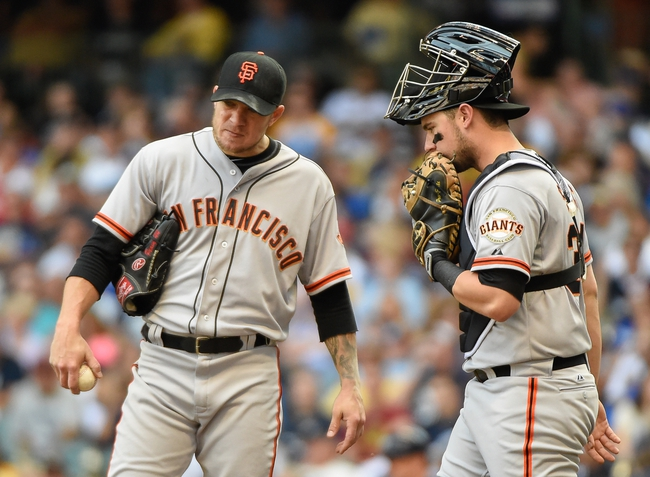 Aug 7, 2014; Milwaukee, WI, USA;  San Francisco Giants pitcher Jake Peavy (43) gets a mound visit with catcher Andrew Susac (34) in the fifth inning at Miller Park. Mandatory Credit: Benny Sieu-USA TODAY Sports