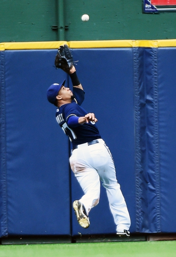 Aug 7, 2014; Milwaukee, WI, USA;  Milwaukee Brewers center fielder Carlos Gomez (27) makes a running catch of ball hit by San Francisco Giants center fielder Gregor Blanco (not pictured) in the ninth inning at Miller Park. Mandatory Credit: Benny Sieu-USA TODAY Sports