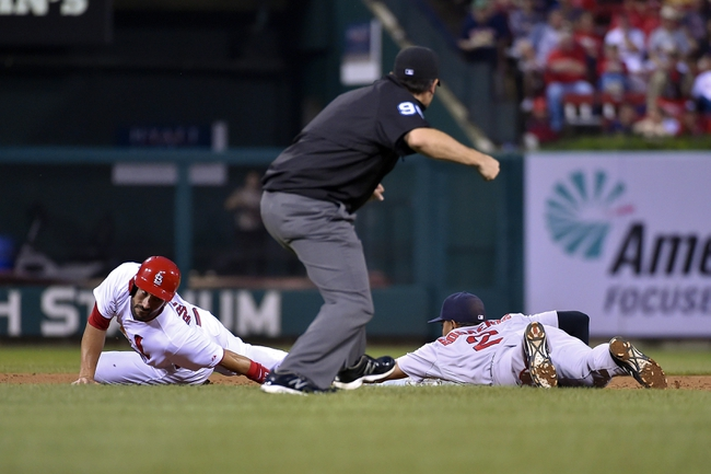 Aug 7, 2014; St. Louis, MO, USA;  St. Louis Cardinals third baseman Matt Carpenter (13) is called out attempting to steal second base against the Boston Red Sox at Busch Stadium. Mandatory Credit: Jasen Vinlove-USA TODAY Sports