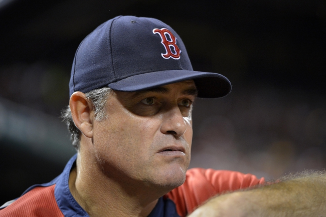 Aug 7, 2014; St. Louis, MO, USA;  Boston Red Sox manager John Farrell (53) stands in the dugout during the game between the St. Louis Cardinals and the Boston Red Sox at Busch Stadium. Mandatory Credit: Jasen Vinlove-USA TODAY Sports