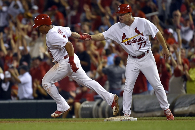 Aug 7, 2014; St. Louis, MO, USA;  St. Louis Cardinals first base coach Chris Maloney (77) congratulates second baseman Kolten Wong (16) after hitting a home run against the Boston Red Sox at Busch Stadium. Mandatory Credit: Jasen Vinlove-USA TODAY Sports